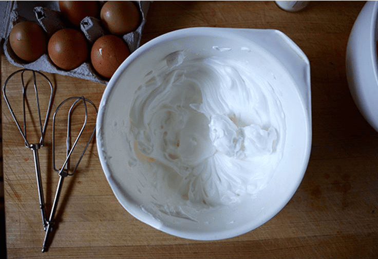 """<img src=""""cloud_bread_whipped_raw.png"""" alt=""""cloud bread raw whipped in a bowl""""/>"""